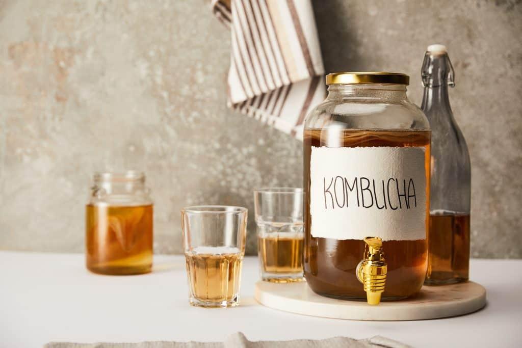 kombucha tea dispenser and bottle with glasses