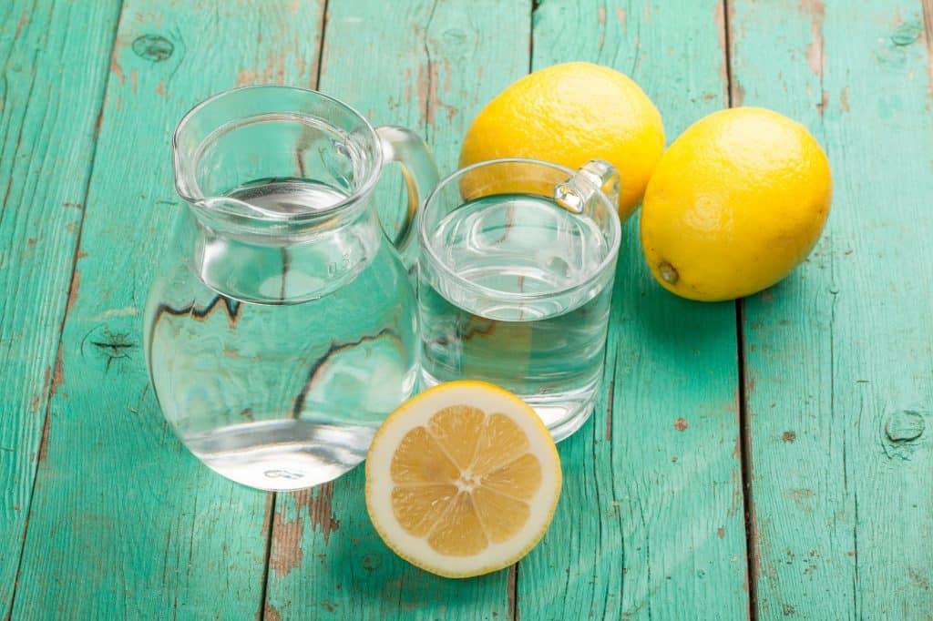 jug of water and a sliced lemon