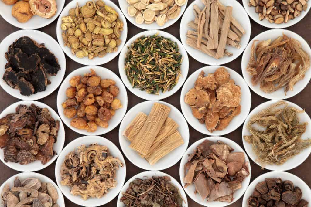 A selection of Chinese medicine herbs in bowls