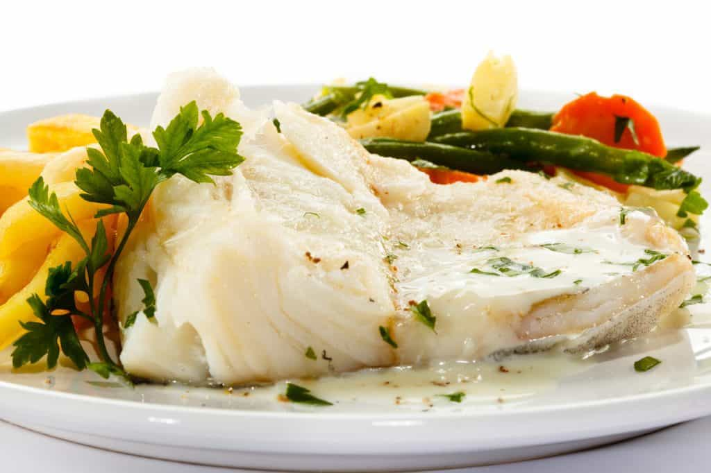 cooked cod dinner with vegetables