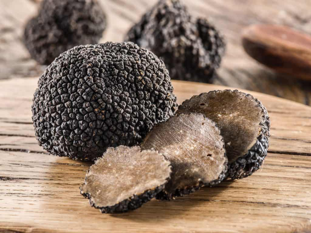 black truffles on a wooden table