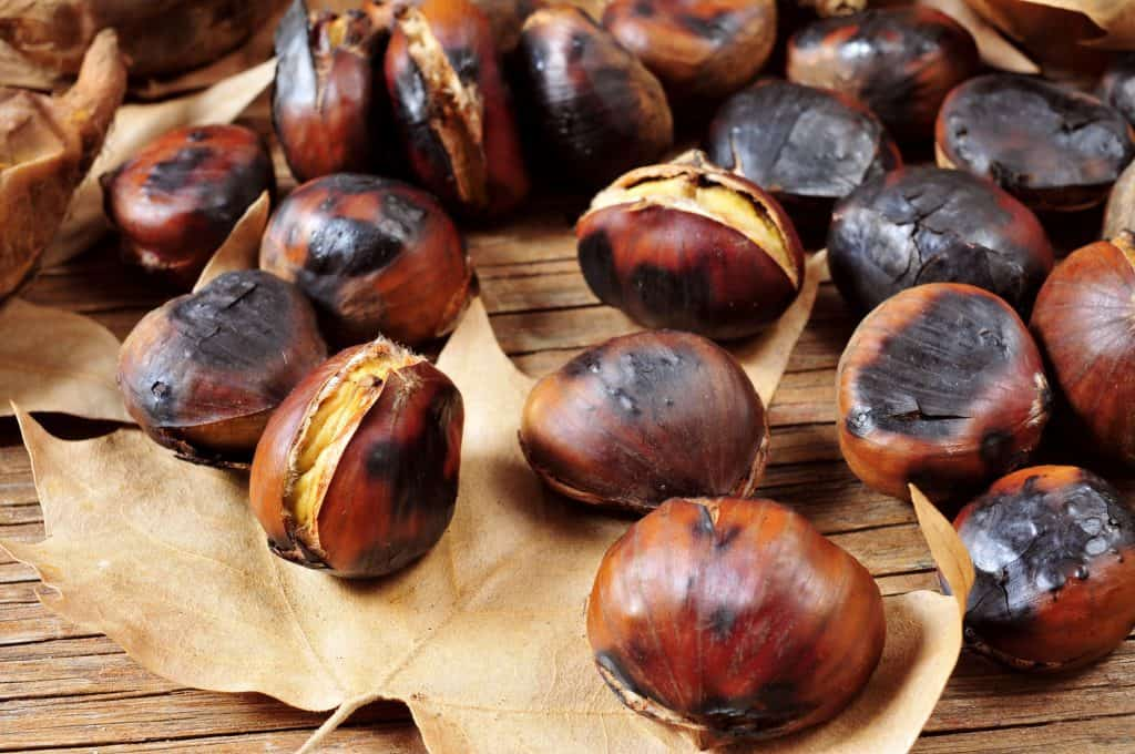 roasted chestnuts on a wooden table