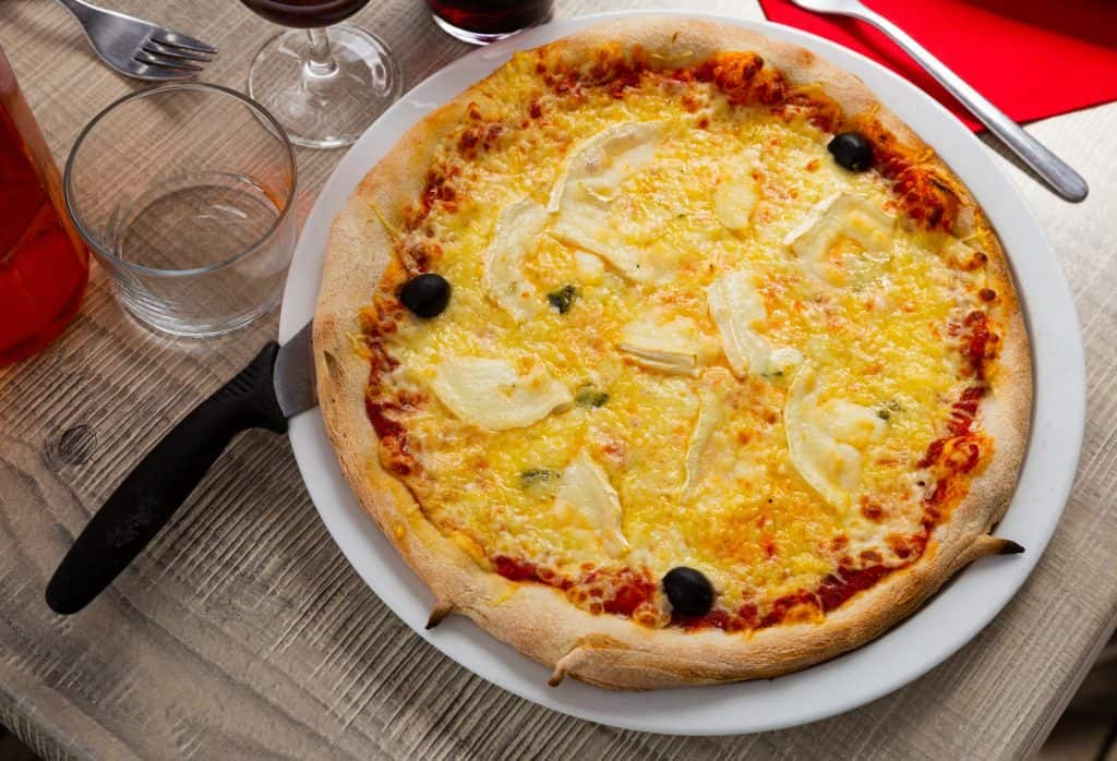 fontina pizza on a table