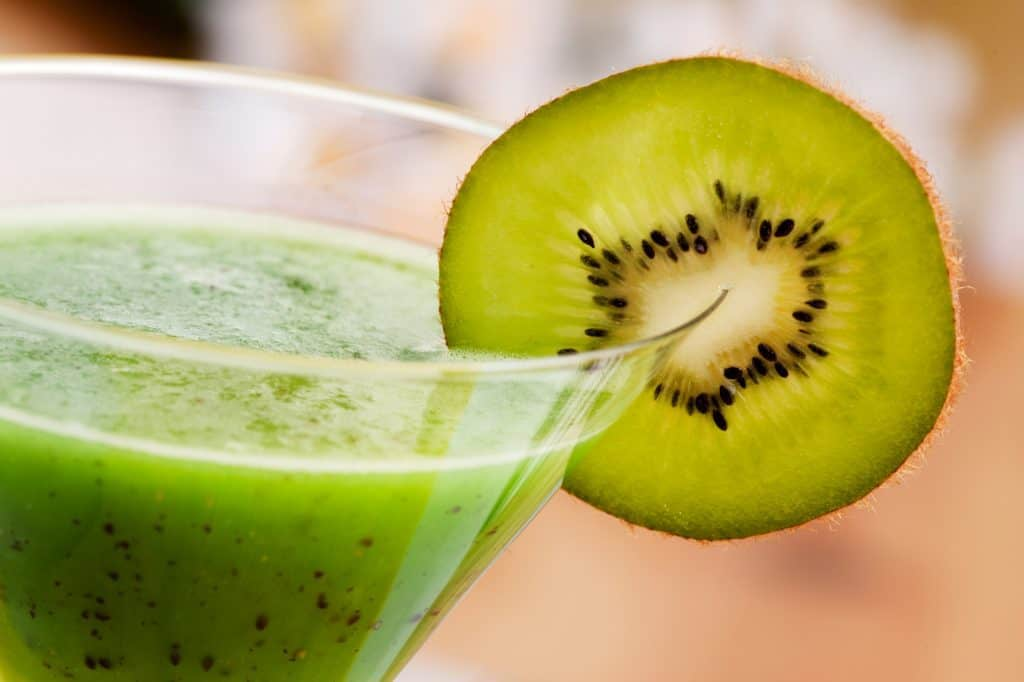 A kiwi smoothie in a glass